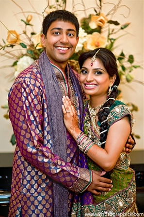 Portrait of Indian bride and groom at their Indian wedding garba party.