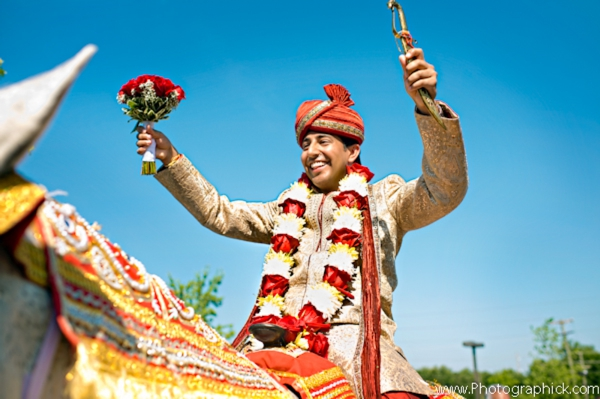 Indian groom arrives at Indian wedding on a baraat.