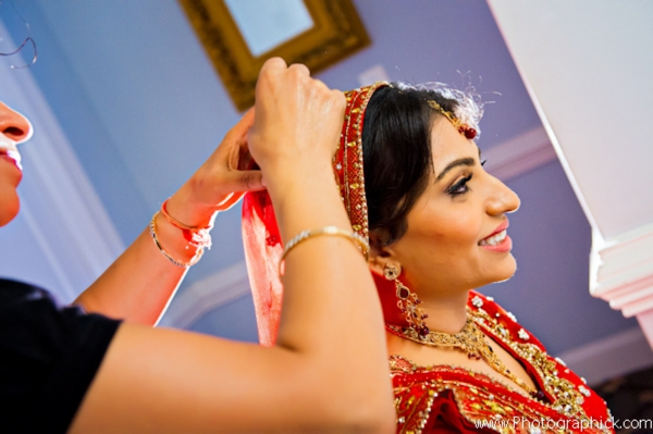 Indian bride gets Indian bridal hair and makeup done.
