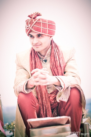 groom at indian wedding in traditional indian wedding outfit.