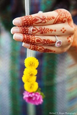 Pakistani bride with mehndi on her hands.