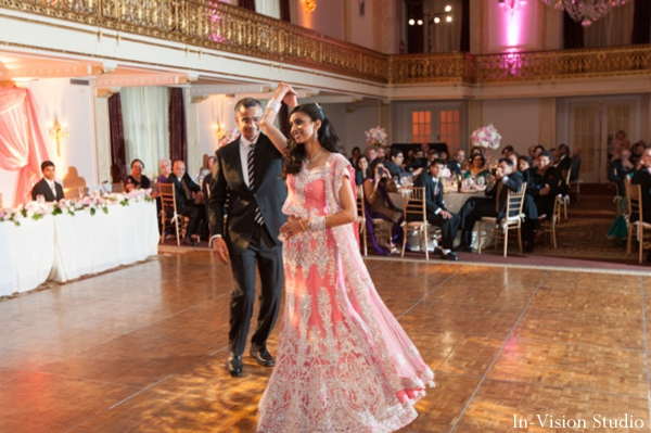 Indian bride wears pink wedding lengha for indian wedding reception.
