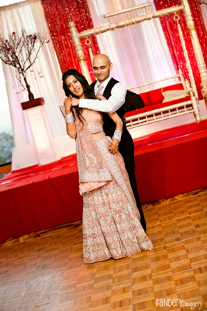 Indian bride and groom dance at their modern indian wedding reception.