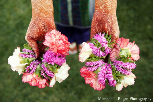 Pakistani wedding floral arrangements and mehndi hands.