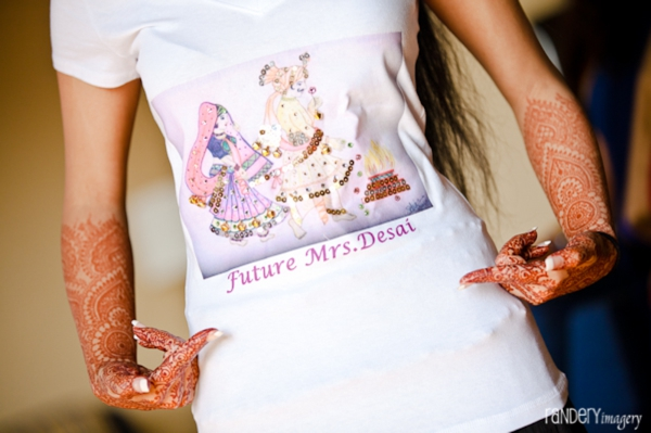 Indian bride shows off bridal mehndi on hands.