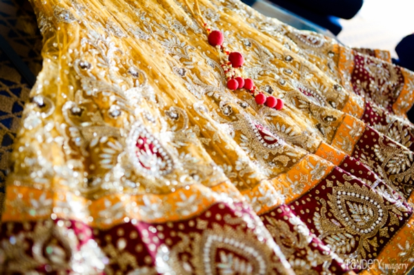 Indian wedding lengha in red and gold.