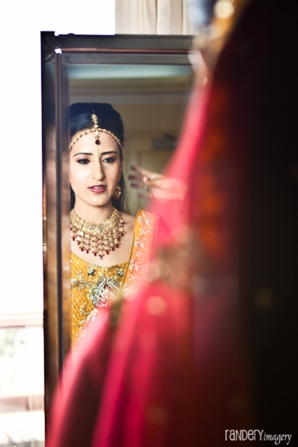 Indian bridal hair and makeup before indian wedding.