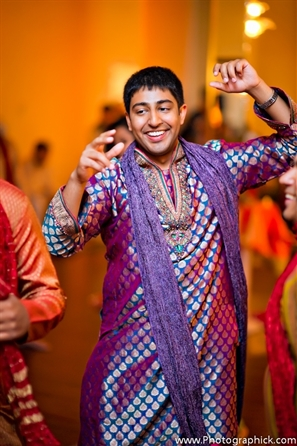 Indian wedding garba shows Indian groom in traditional garba kurta.
