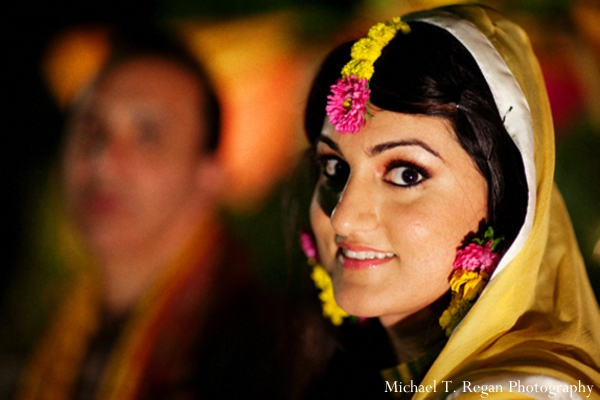 Pakistani bride in yellow chuni and wedding lengha.