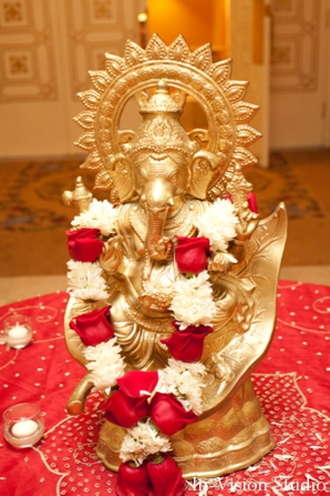 Indian wedding decor includes ganesh statue.