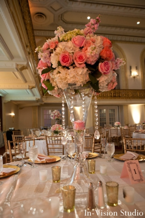 pink and white flower centerpieces at indian wedding reception.