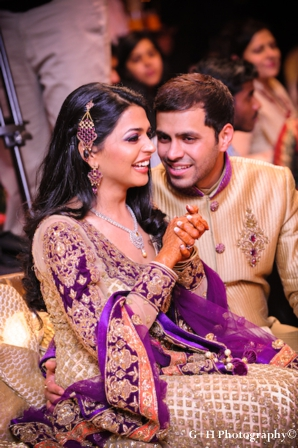 Indian bride and groom in matching wedding outfits for engagement