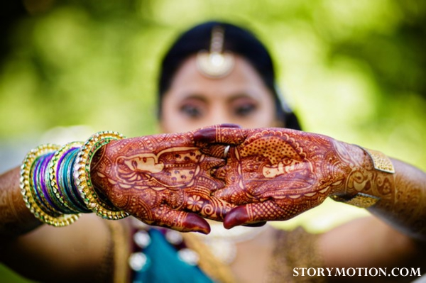 Indian bride wears bridal mehndi on her hands.