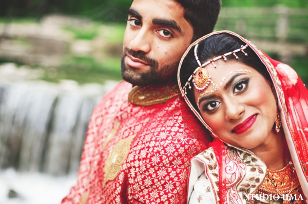 Indian bride and groom in traditional indian wedding outfits.