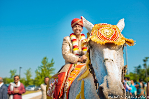 Indian groom on indian wedding day in a baraat.