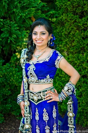 Indian bride in blue bridal lengha fashion.