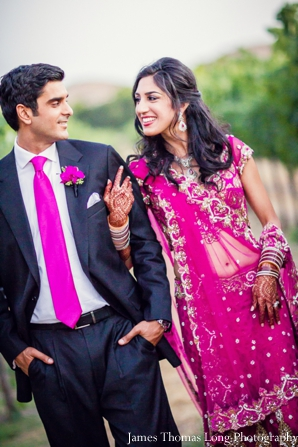 indian bride in pink wedding lengha.