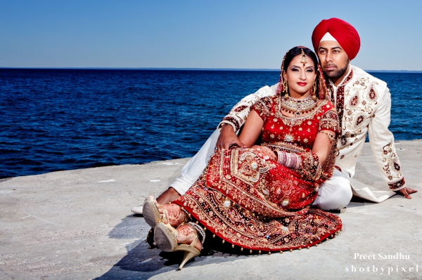 Indian bride and groom by the sea.