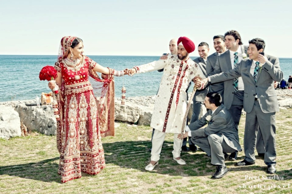 Indian bride and groom portrait with groomsmen.