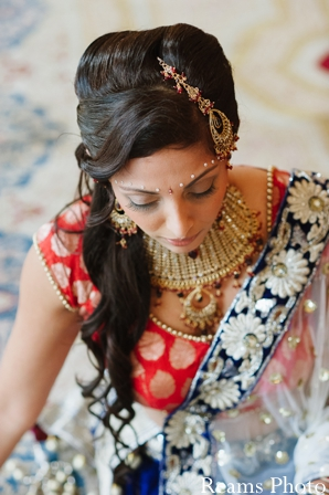Indian bride chooses fashionable bridal lengha for indian wedding ceremony.