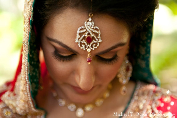 Pakistani bride wears ruby and diamond tikka.