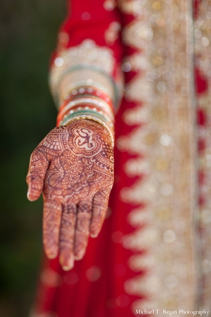 Bridal mendhi shown off by pakistani bride.
