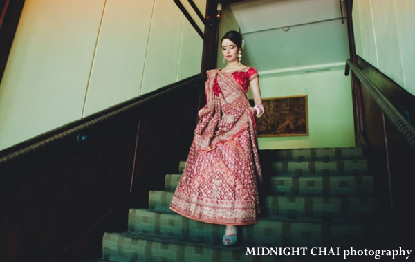 Indian bride wears red wedding lengha to indian wedding.