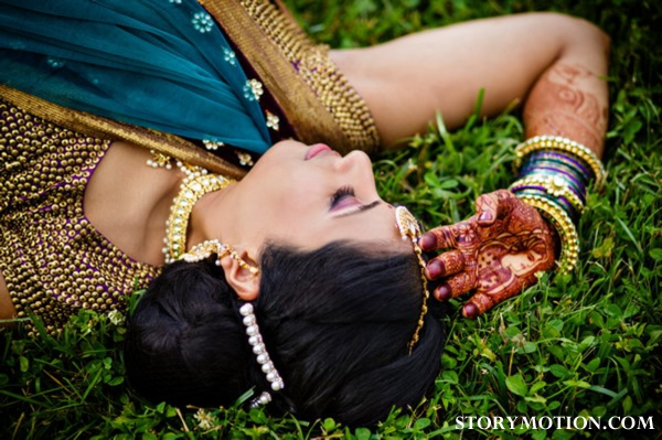 Indian bride with bridal mehndi and hair and makeup ideas.
