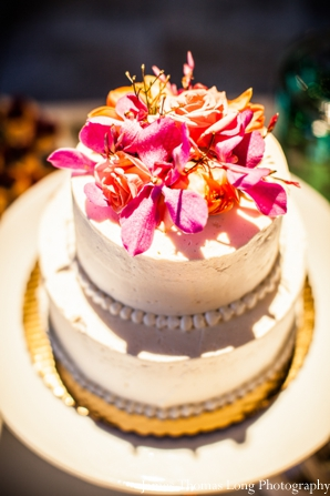 indian wedding cake with fresh flowers.