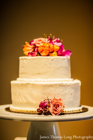 modern indian wedding cake with fresh flowers.