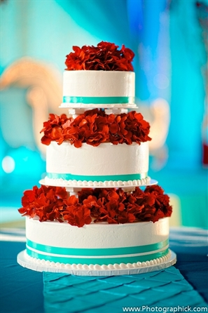 Indian wedding cake in a modern three tier design with real petals.