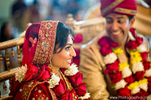 Indian bride wears traditional bridal lengha with matching jaimala.