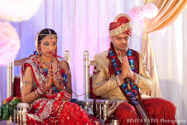 An indian bride and groom at their modern hindu indian wedding.