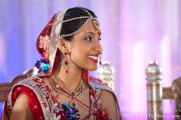 Indian bride wears traditional bridal lengha and indian wedding jewelry.