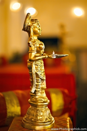 Indian wedding decor ideas with gold statues.