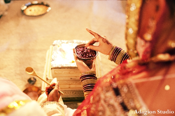 indian wedding traditional rituals at the ceremonial mandap.