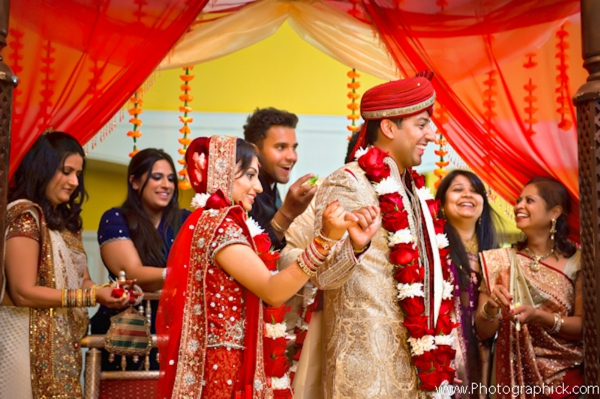 Indian bride and groom dressed in traditional indian wedding outfits.