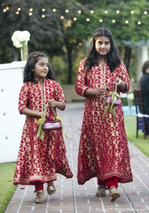 pakistani wedding flower girls at a ring exchange ceremony.