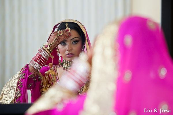 indian bride adjusts indian bridal jewelry set.