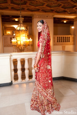 Indian bride wears classic red indian wedding lengha.