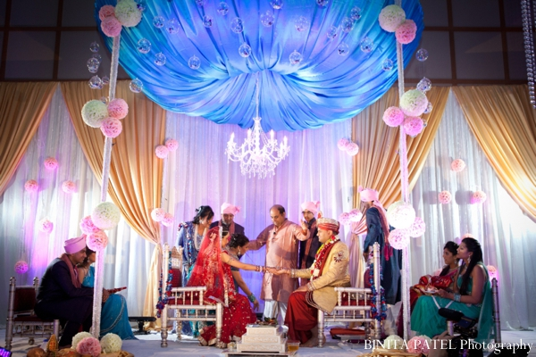 A modern mandap is the centerpiece of this indian wedding ceremony.