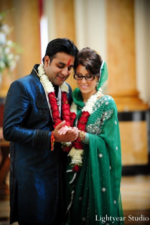 Indian bride and groom in modern Indian wedding wear.