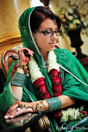 Indian bride in modern bridal lengha and indian bridal jewelry set.