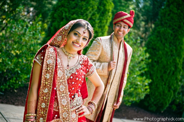 Indian bride and groom in indian wedding day portrait.