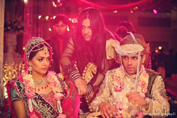 Indian bride and groom in pink and gold marry at indian wedding ceremony