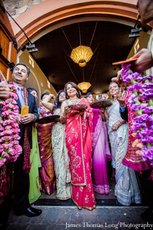 indian bride's family greets groom at indian wedding