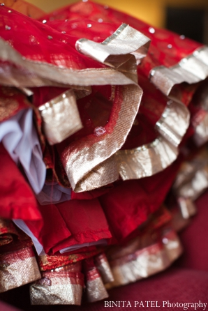 Indian wedding lengha ruffles in red and gold.