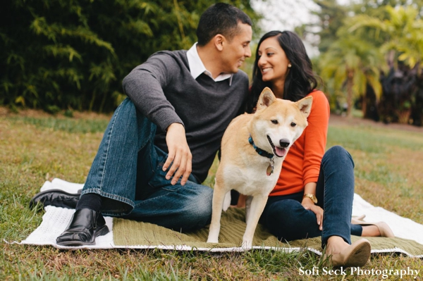 Indian bride and groom take engagement photos in the park with dog