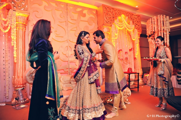 Indian bride and groom in traditional wedding outfits