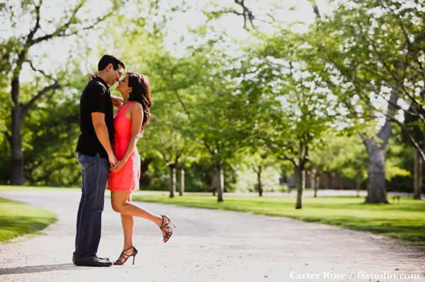 indian bride and groom take engagement photos in park.